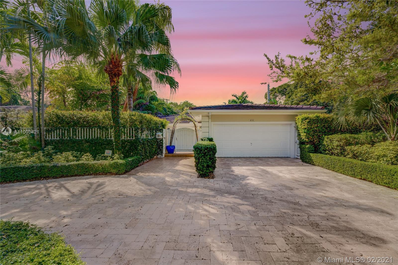 Riviera Golf Course home located in the heart of Coral Gables with lush landscaping surrounding this