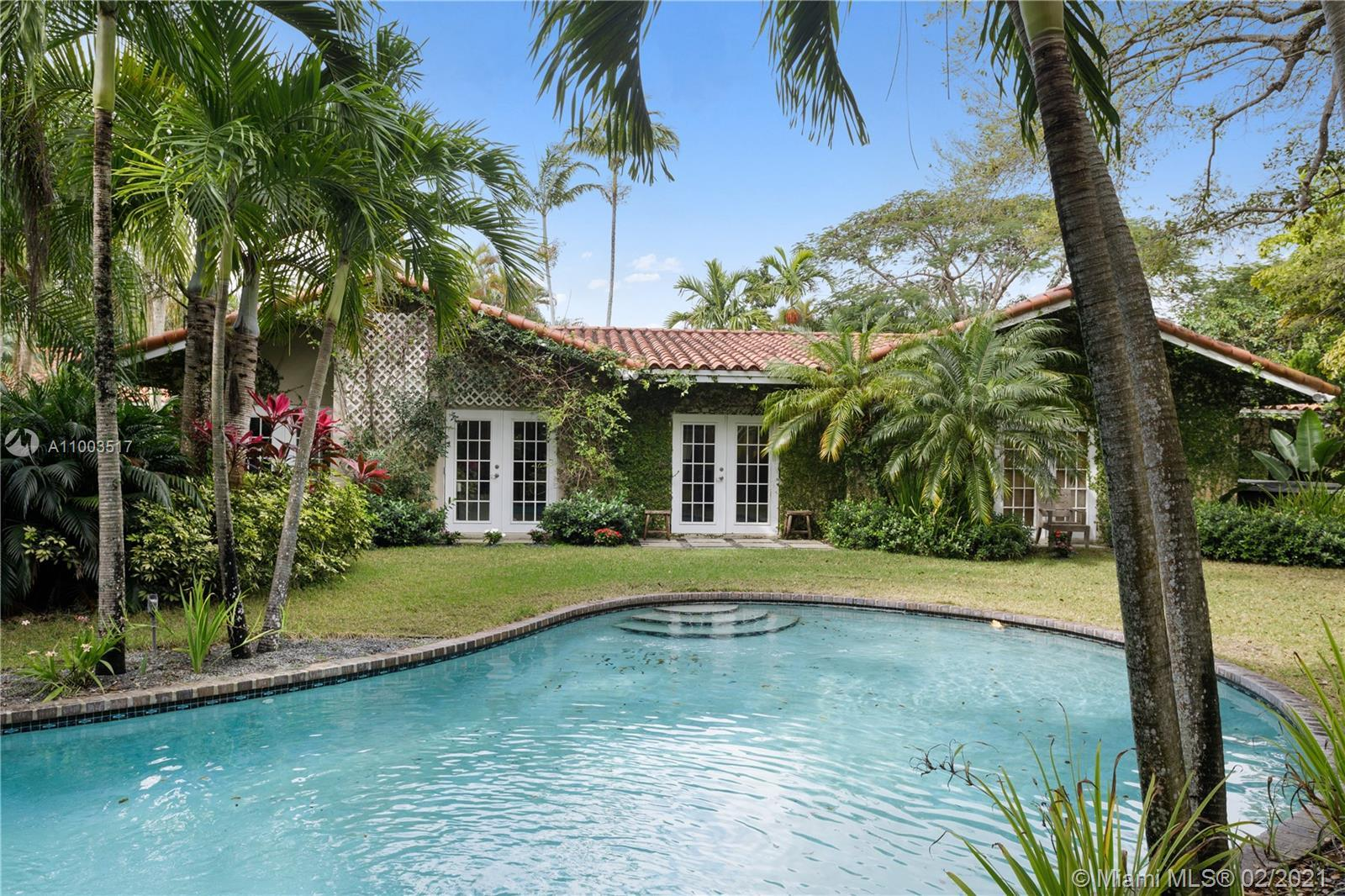 Beautiful Pinecrest ranch style pool home surrounded by lush tropical fruit trees on huge lot (52,00