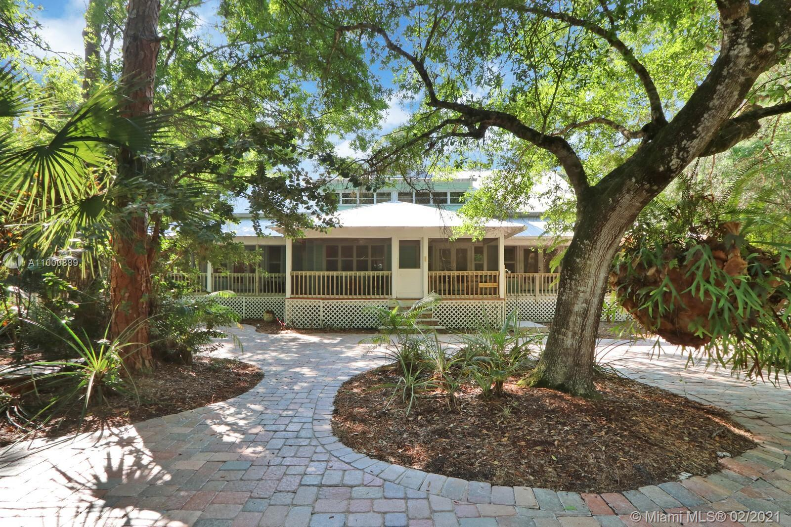 One of the most majestic homes you will find in Jupiter Farms.  Southern plantation home with a full