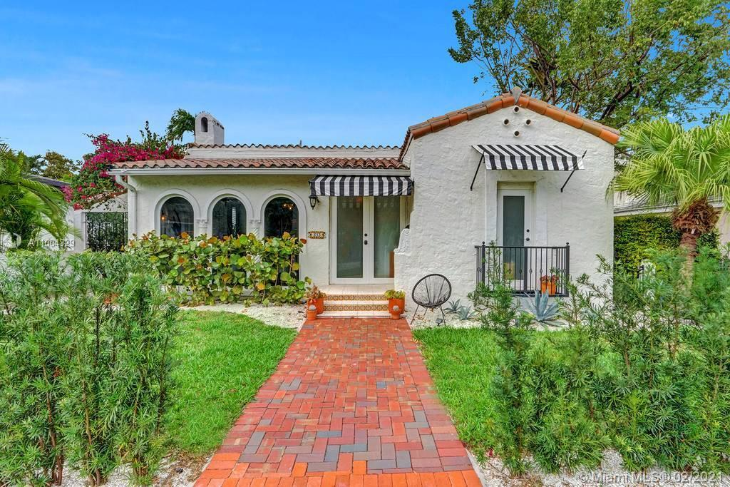This stunning Old Spanish home with lots of charm boosting high ceilings with exposed wood beams in