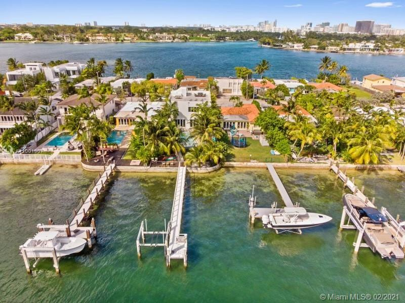 Extraordinary two story waterfront home built in 2015 with the largest rooftop terrace on the Island
