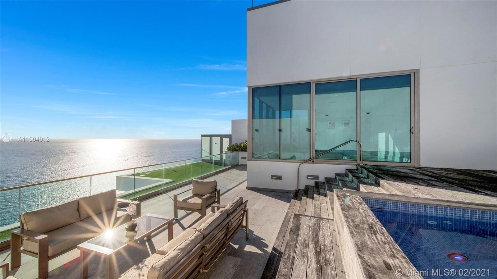 Dive into the ocean from this upper penthouse at the luxurious Oceana Bal Harbour Condo. World-clas