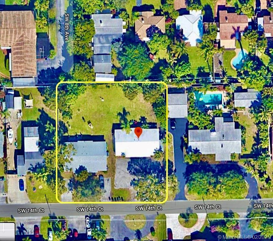 Rare opportunity to own a 4300 SF income producing property on HALF AN ACRE in Downtown Fort Lauderd