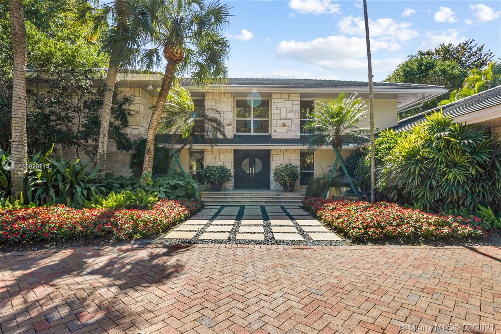 Elegance in Pinecrest. Large updated residence with separate guest house, heated pool and tennis cou