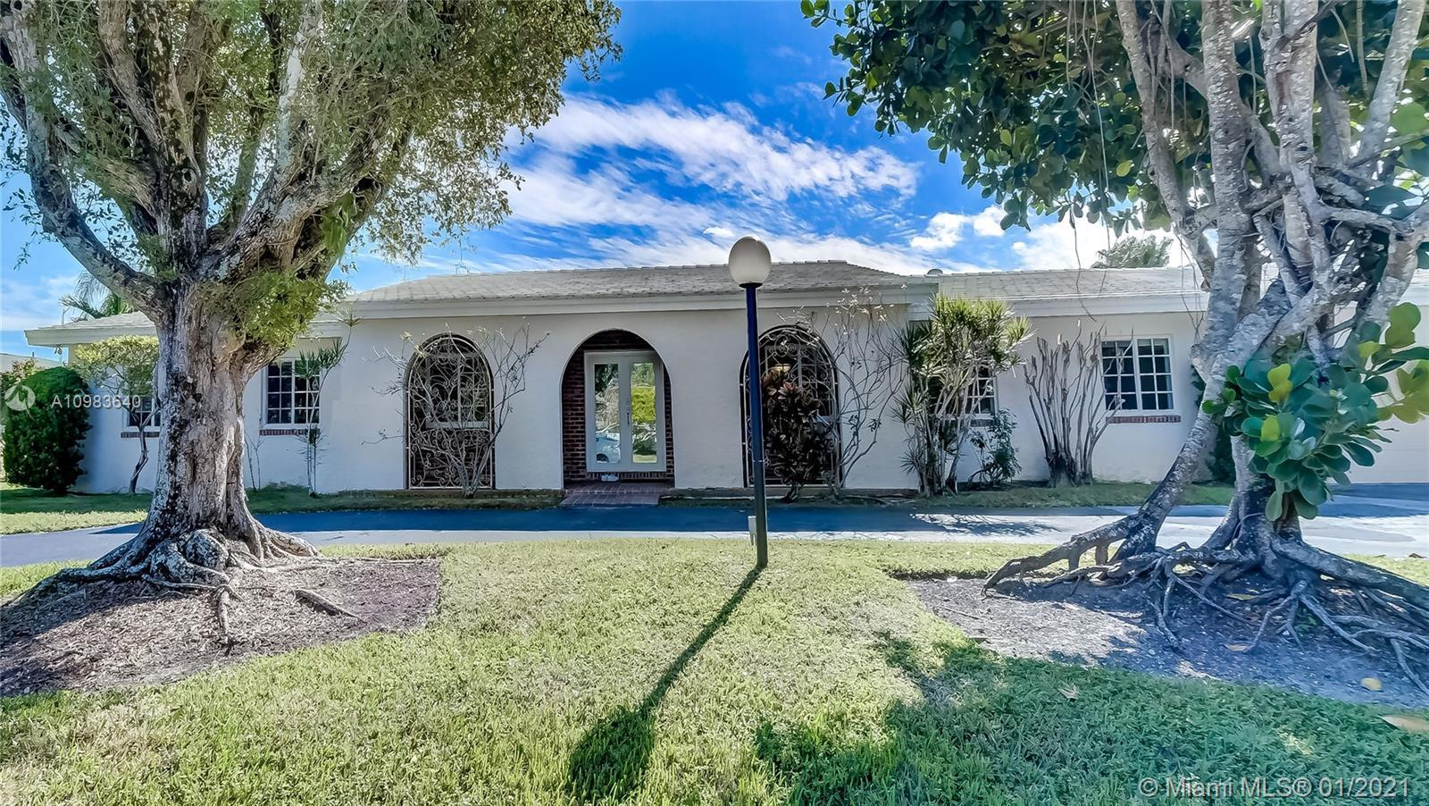 Stunning one-story home located on a wide canal in Pinecrest. This extremely bright 6 beds/3 baths +