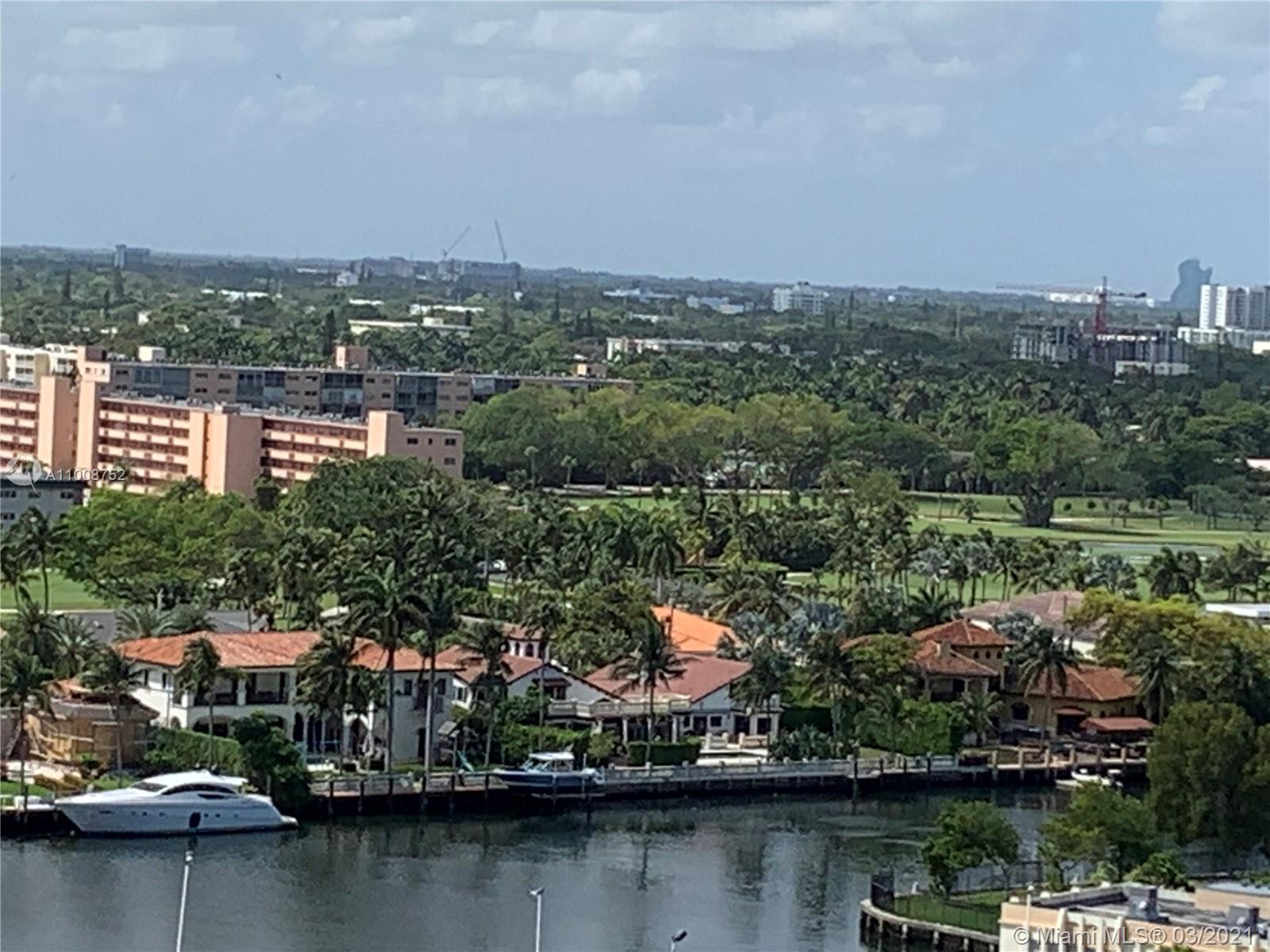 FULL 2 BEDROOM CORNER WITH VIEWS OF THE DIPLOMAT WATERWAY & GOLF COURSE FROM THE LARGEST BALCONY IN