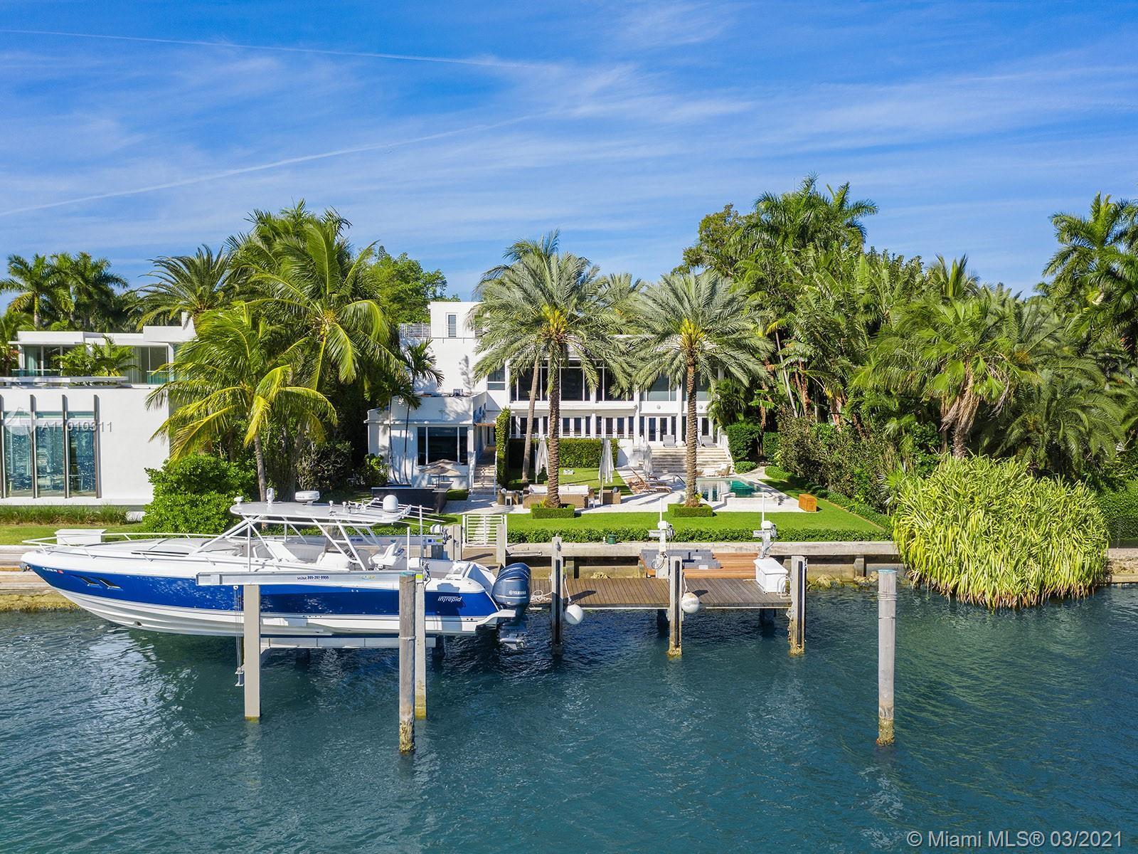 This picturesque contemporary estate is located minutes from South Beach and Downtown Miami, set apa