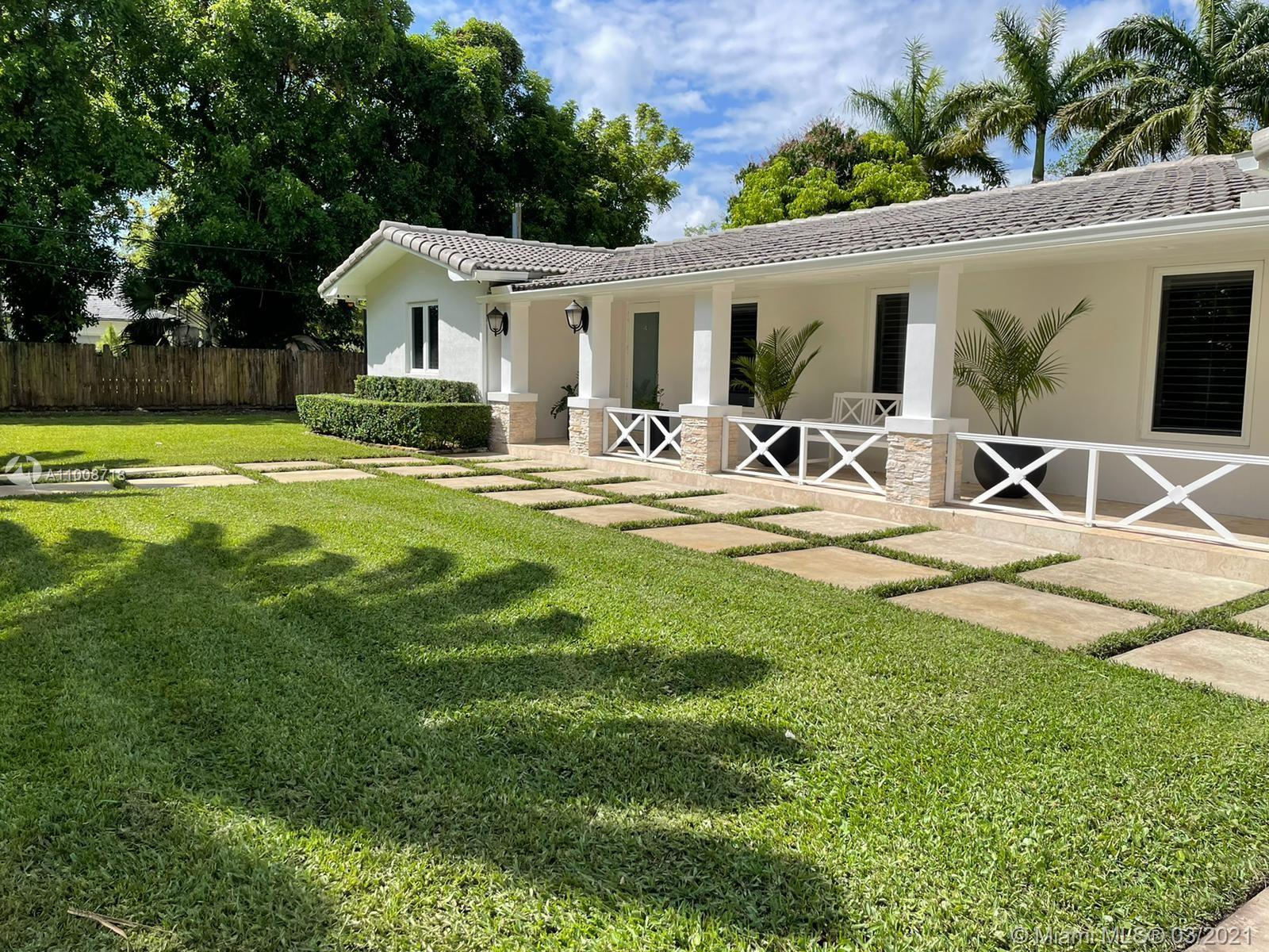 Pristine 3/2 on over 30K sqft lot.  Completely fenced with state of the art hedge. Palm trees galore