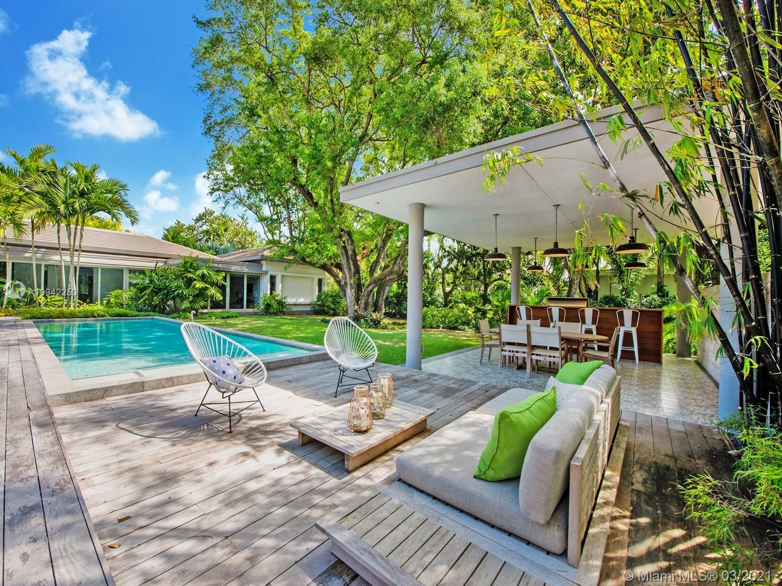 Custom Built Mid Century-Tropical Modern estate located in N Pinecrest. A tropical paradise nestled