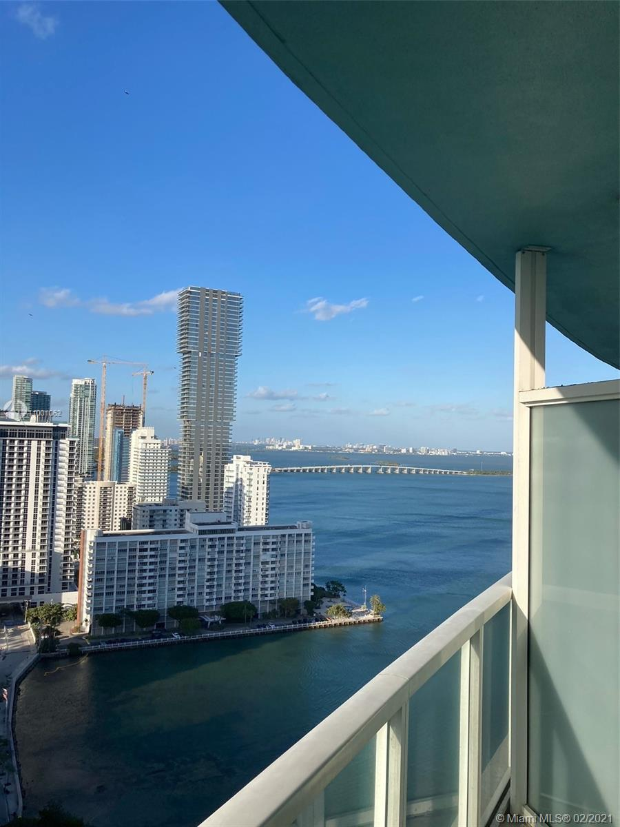 1 Bedroom with north and easterly Beautiful Bay Views from a large balcony in a well maintained cond
