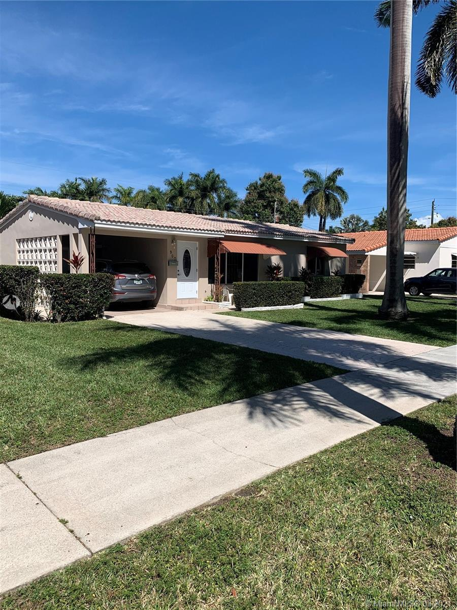 Beautiful home on a quiet palm-lined street in east Hallandale Beach. Close to shops, restaurants, A