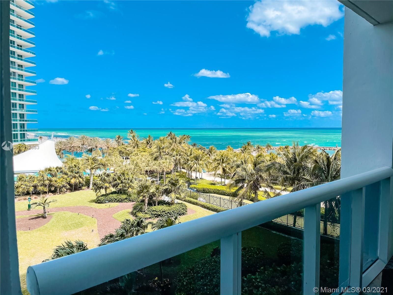 Stunning direct ocean and bay views, rarely available NE view! Spacious one bedroom within walking d