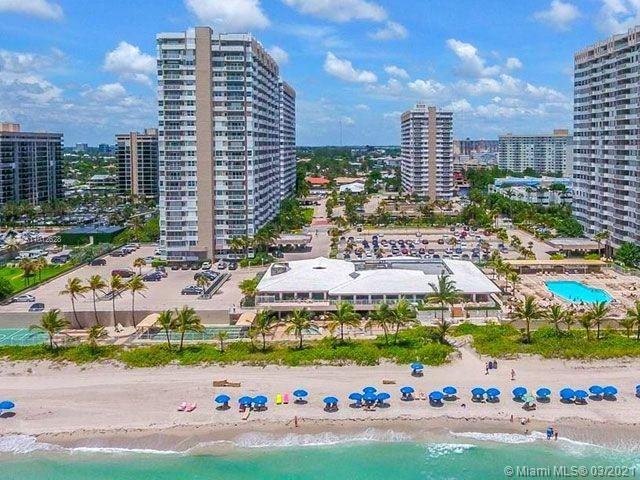 Enjoy an ocean and intercoastal view from the balcony and windows of this completely remodeled 2 bed