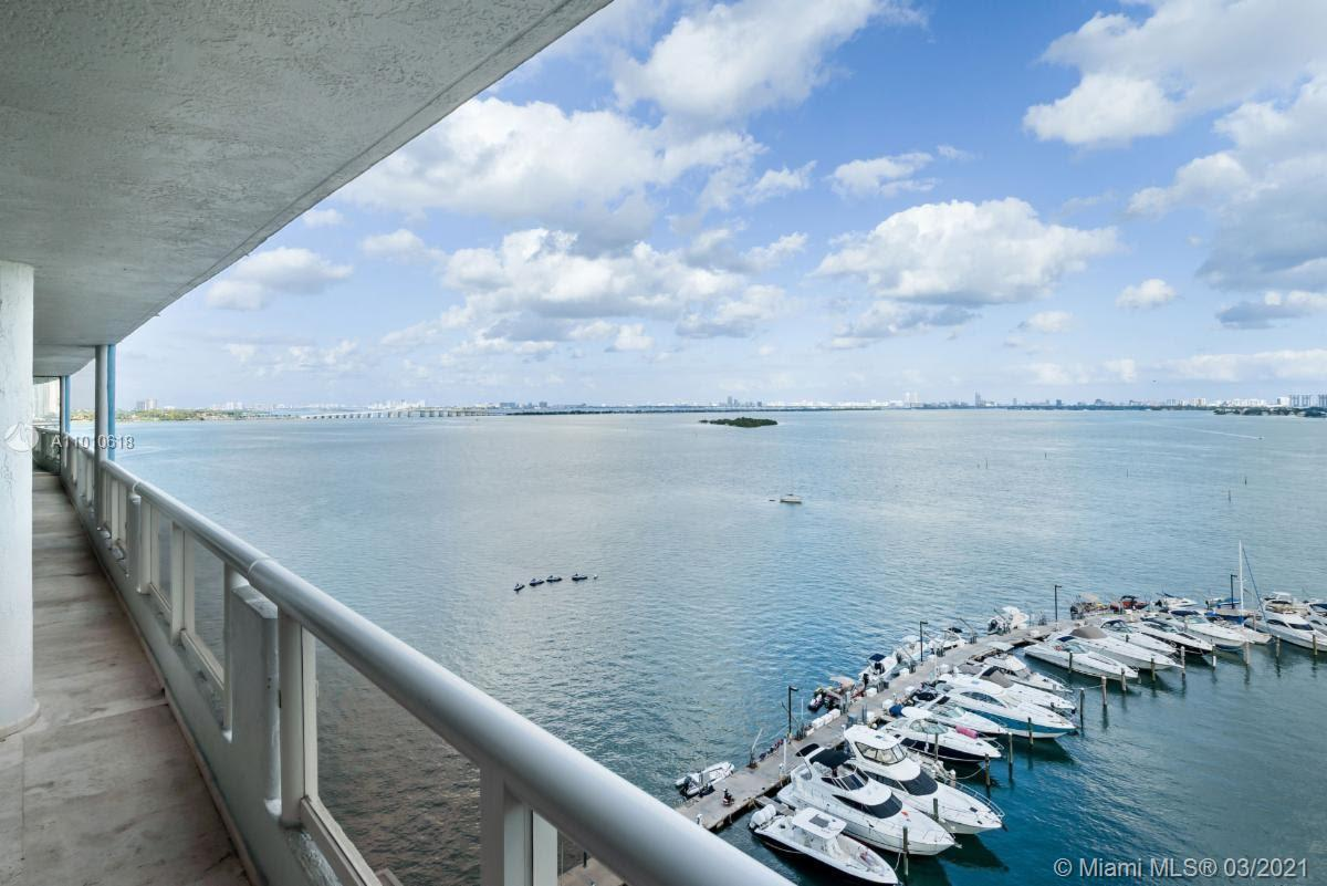 Appointed as a fashion executive's second home, this expansive bay front condominium has it all. Ver