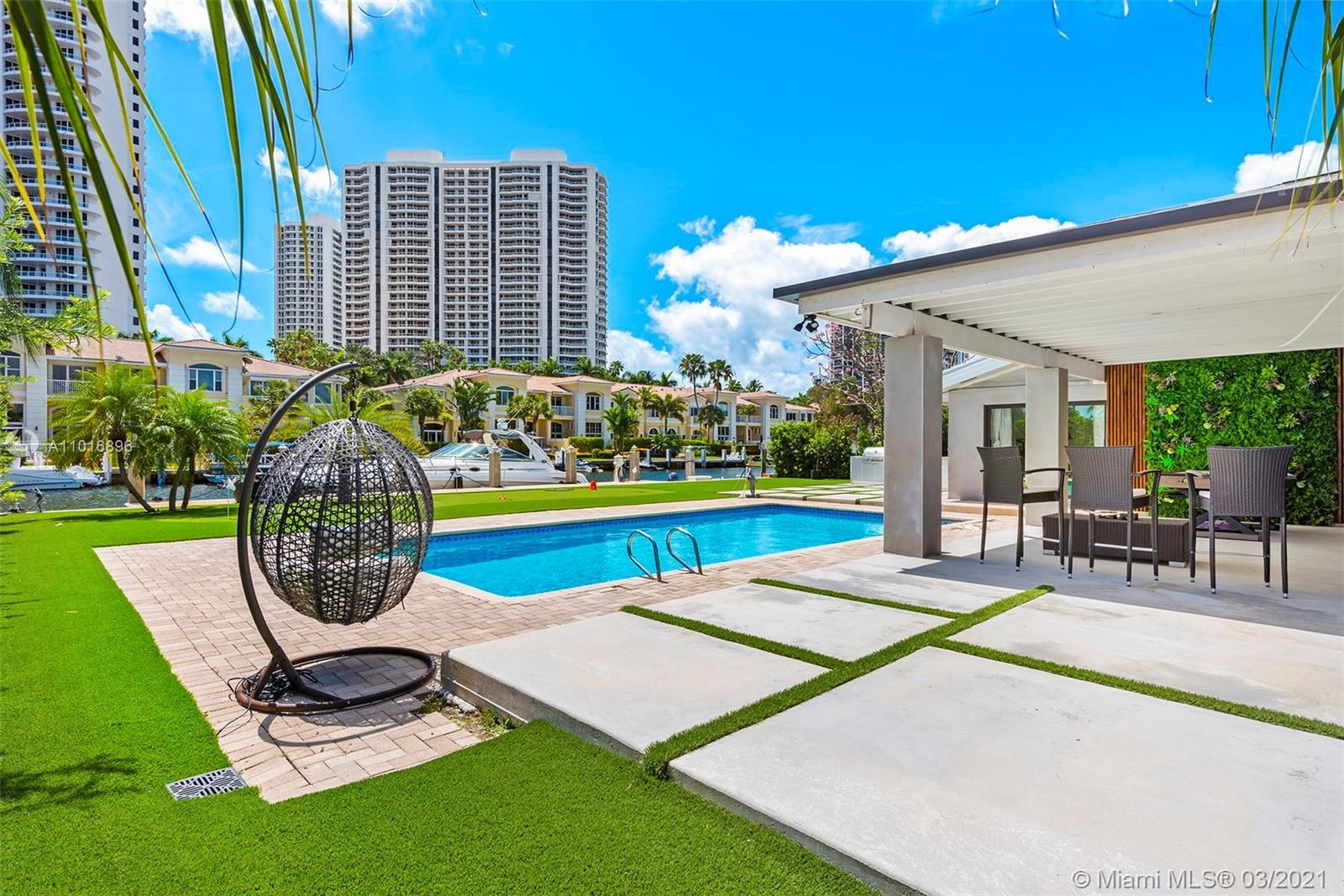 This newly renovated waterfront oasis in the exclusive gated community of Golden Isles offers paradi