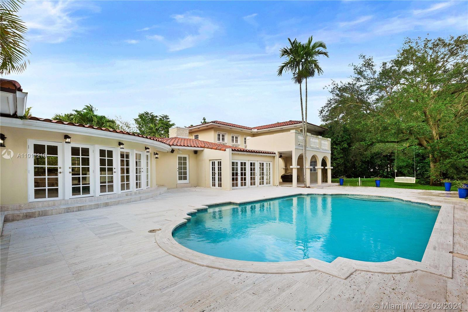 Gated North Pinecrest perfect corner acre. Grand 7 bed 7 bath with large formal areas overlooking th