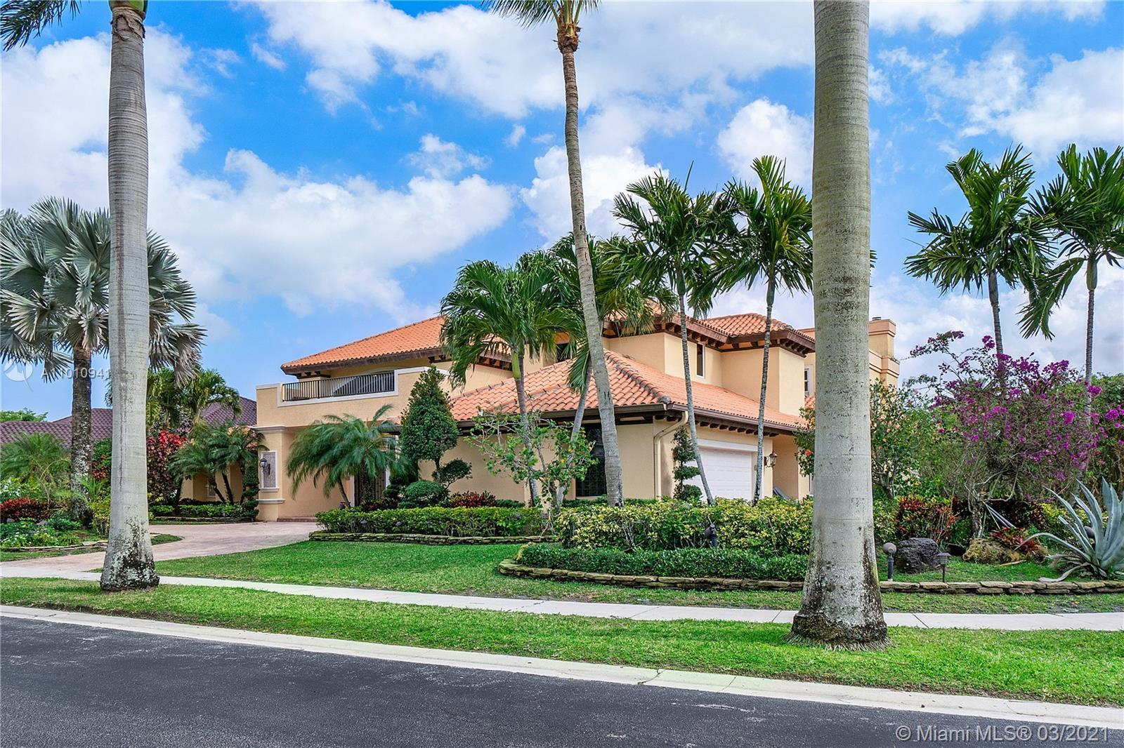 Corner two story estate located within the exclusive gated community of Woodfield CC. Actual square