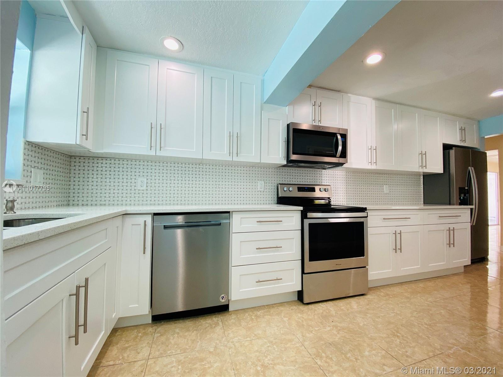 Updated kitchen and baths. Private backyard with pool. Impact windows and hurricane shutters. Must s