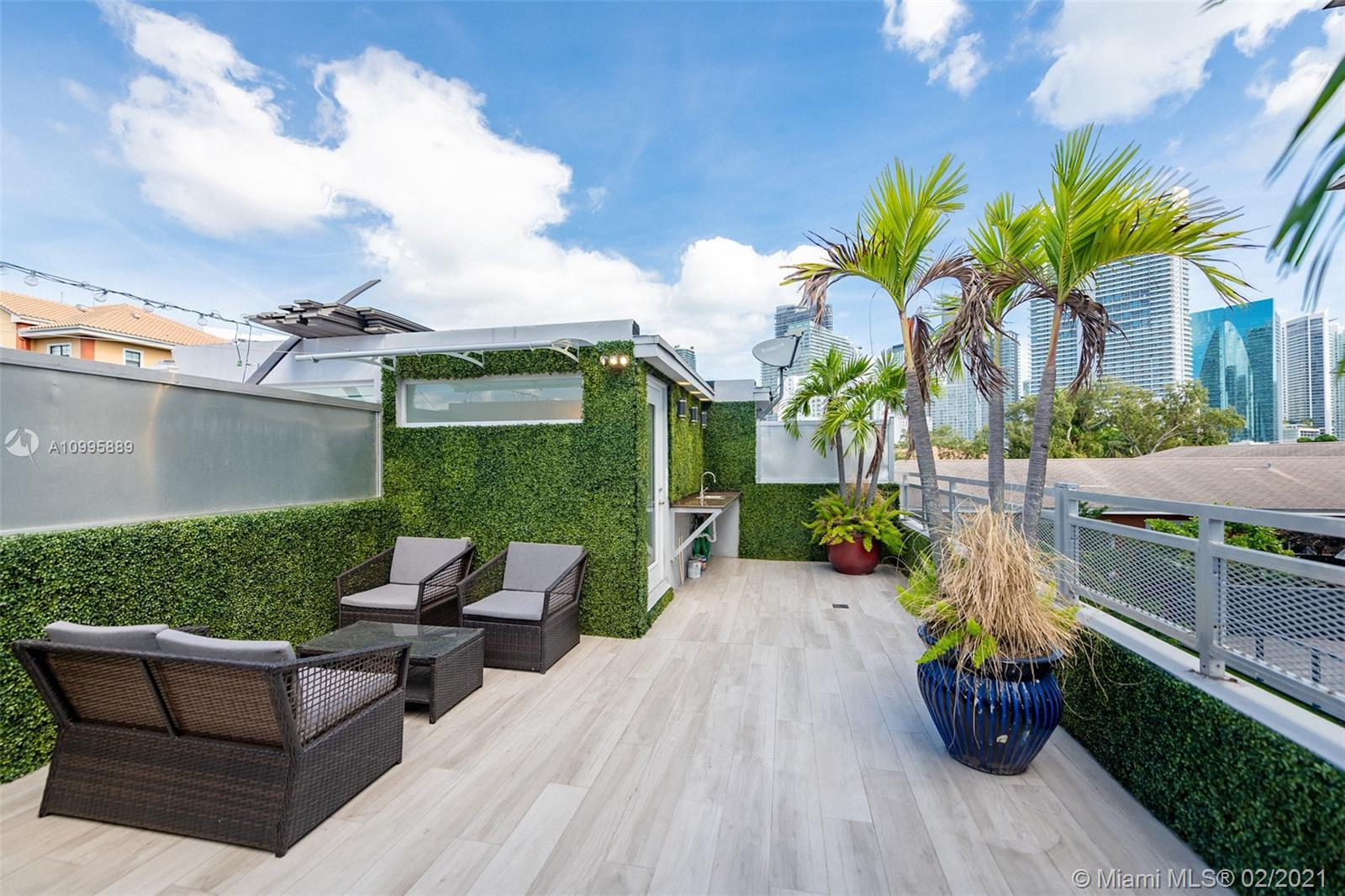 PRIVATE ROOFTOP TERRACE steps from everything Brickell has to offer. Monthly HOA fee of only $297. T