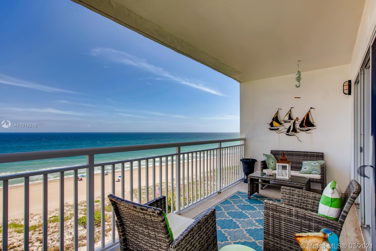 Beachfront condo with unrestricted ocean views! This bright and airy 2 bd / 2 ba unit awaits you wit