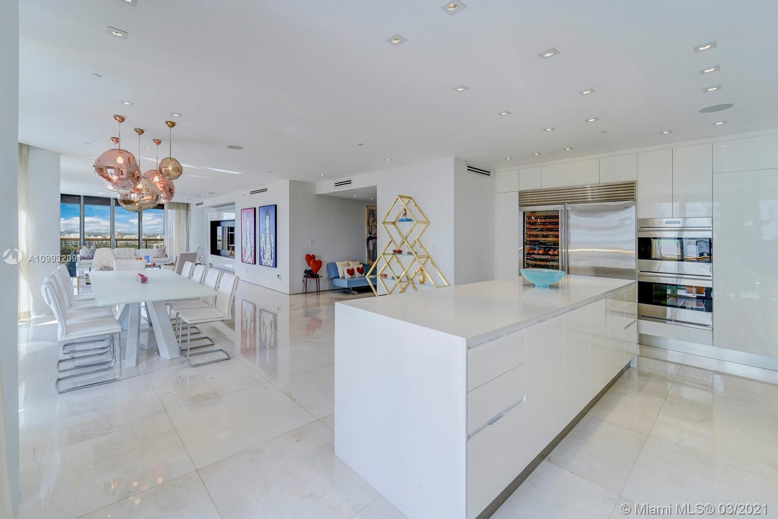 WOW ! This corner remodeled residence w/ gorgeous ocean & city views & stylish upgrades is a rare op
