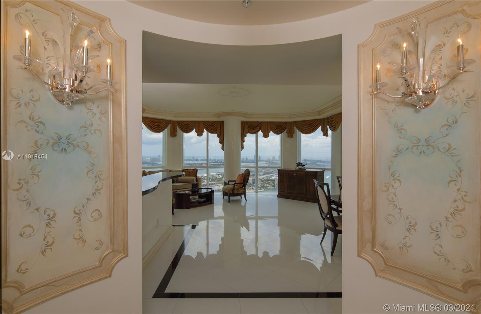 Unobstructed 180 water views, spectacular bay + ocean views, 2 balconies, ceiling to floor glass, de