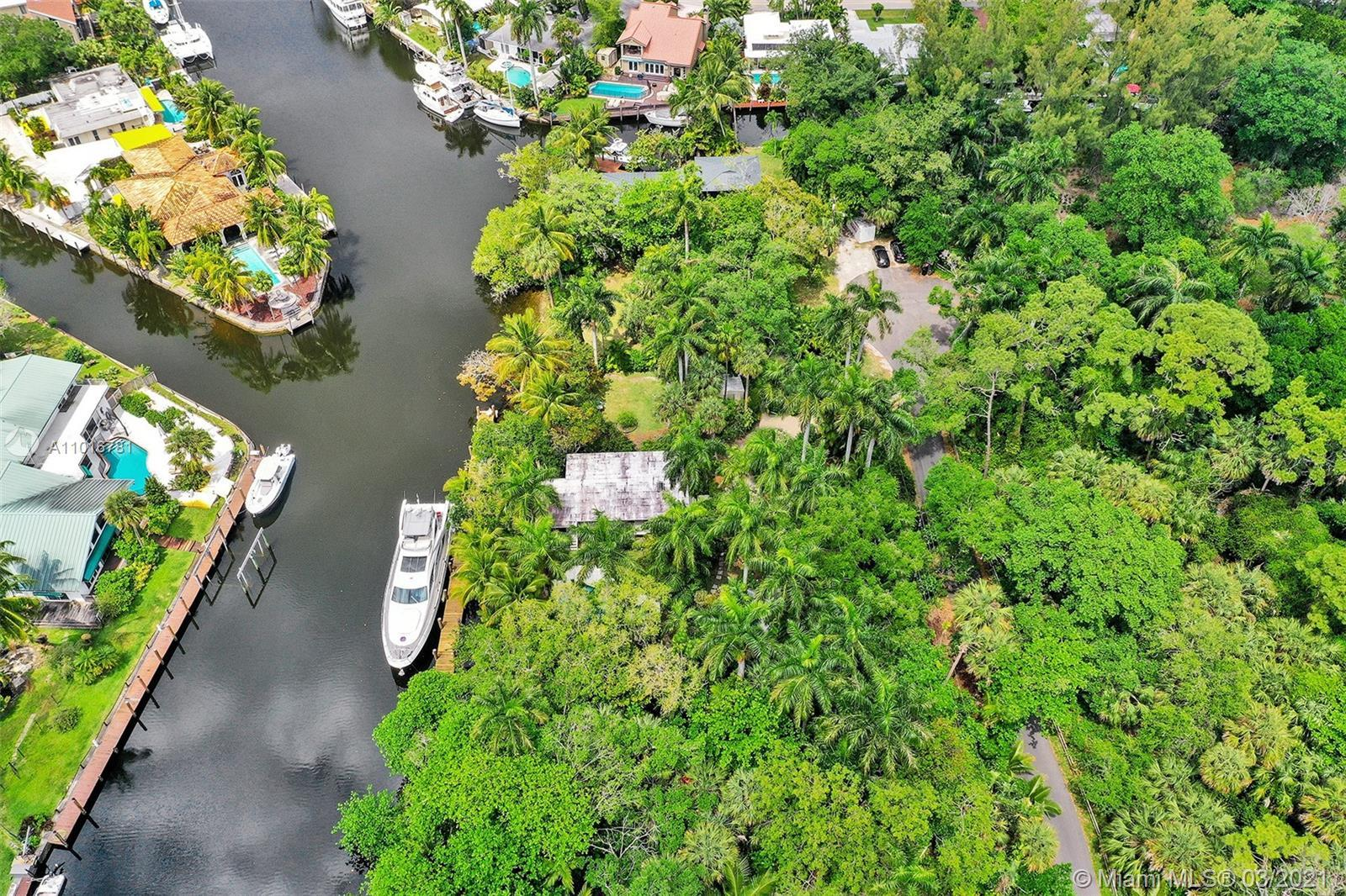 WATERFRONT expansive 31,250 sqft lot with a flair of bohemian tranquil Florida Keys!! Perfect for ve
