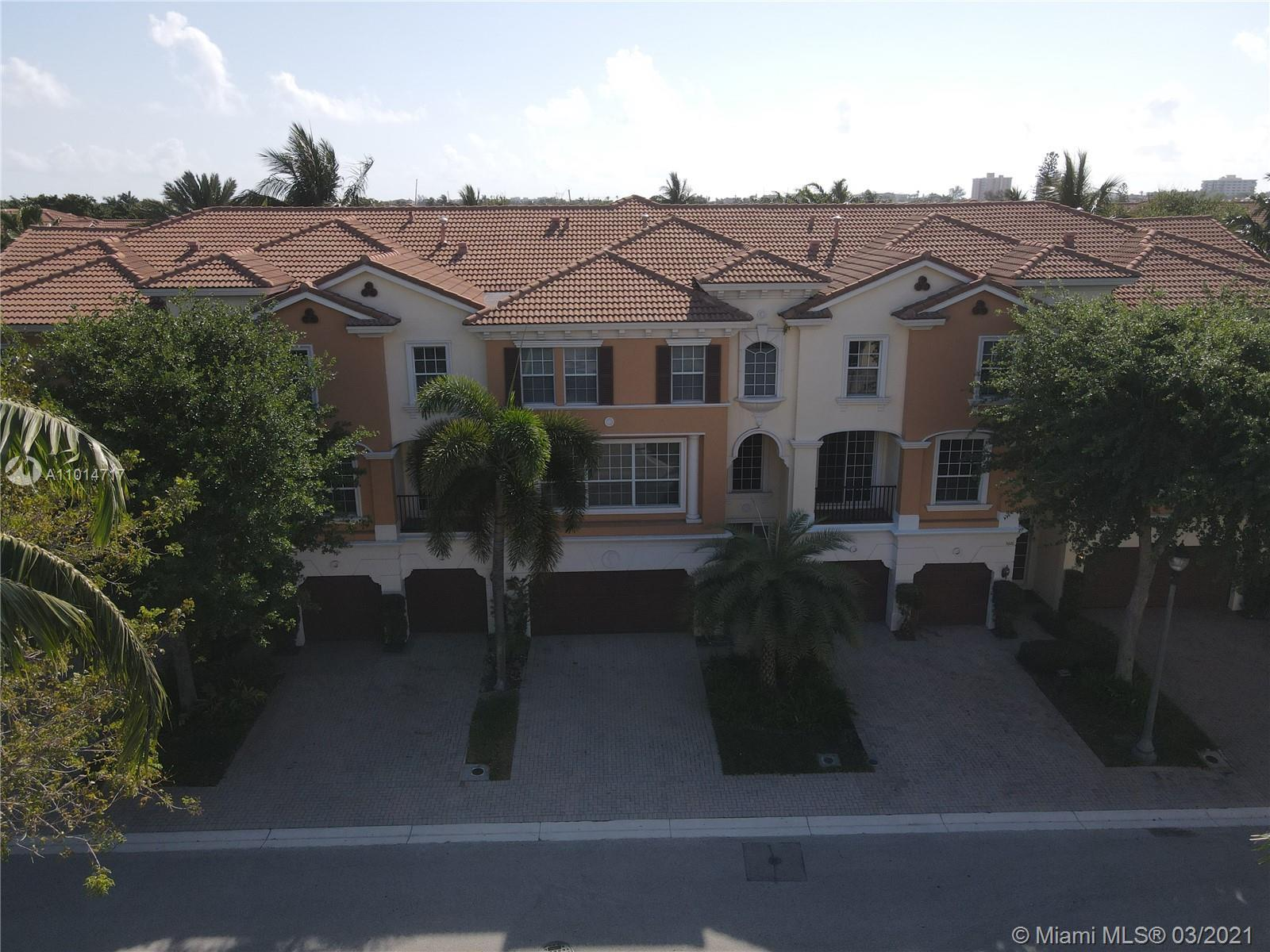 Premier East Boca Location. 3-story townhome with Elevator is perfectly situated & close to shops, r