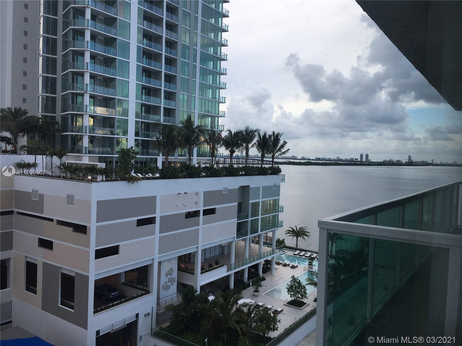 Beautiful condo unit with amazing water view! This bayfront building's amenities include a bayfront