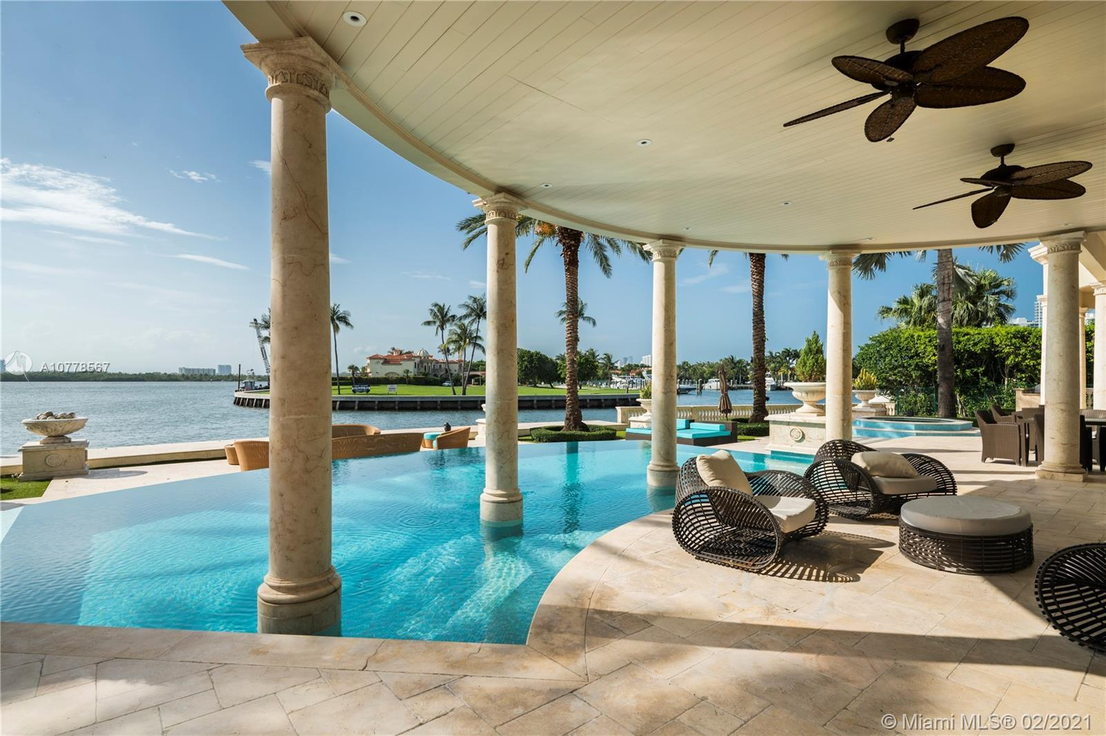 Absolutely unparalleled in finishes, appointments & furniture, this 12,879 SF palatial estate is des