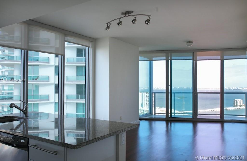 Spacious unit featuring nice layout, wood floors , stainless steel appliances, balconies facing bay