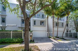 This spectacular tri-level town home with 3 bedrooms & 3 1/2 baths is located in the very desirable