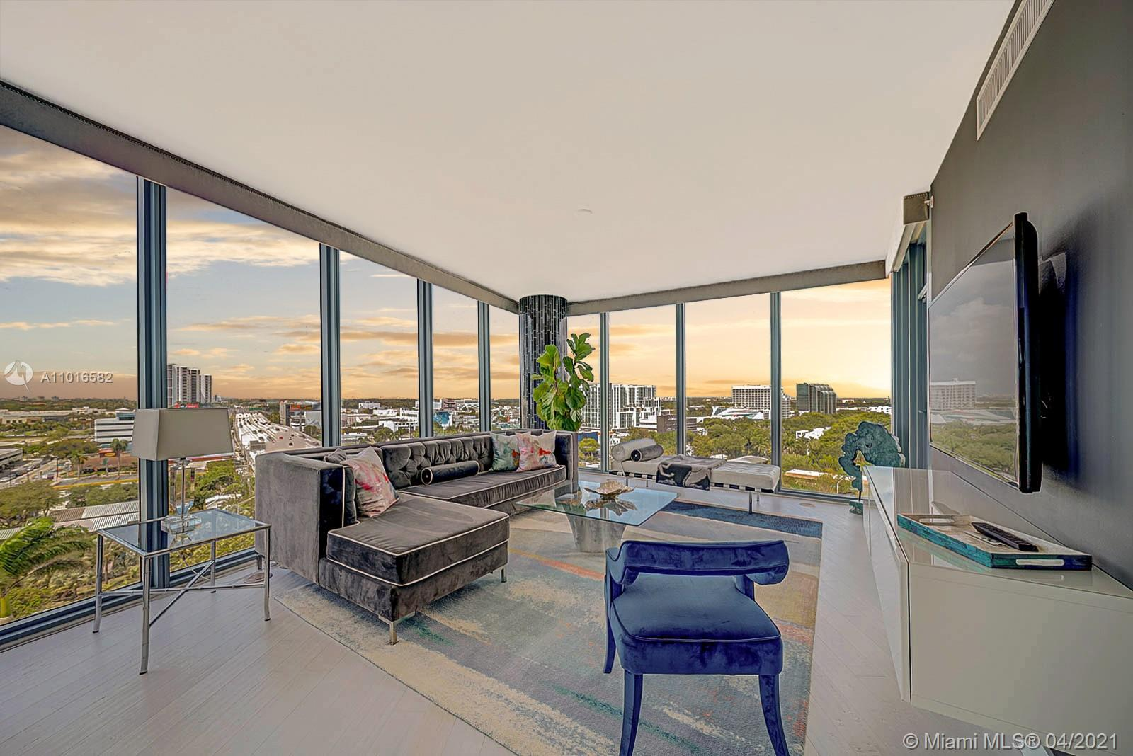 Magnificent 1,449 SF 2 BD/2.5 BTHS corner-unit enveloped in 9-foot glass walls creating pure serenit