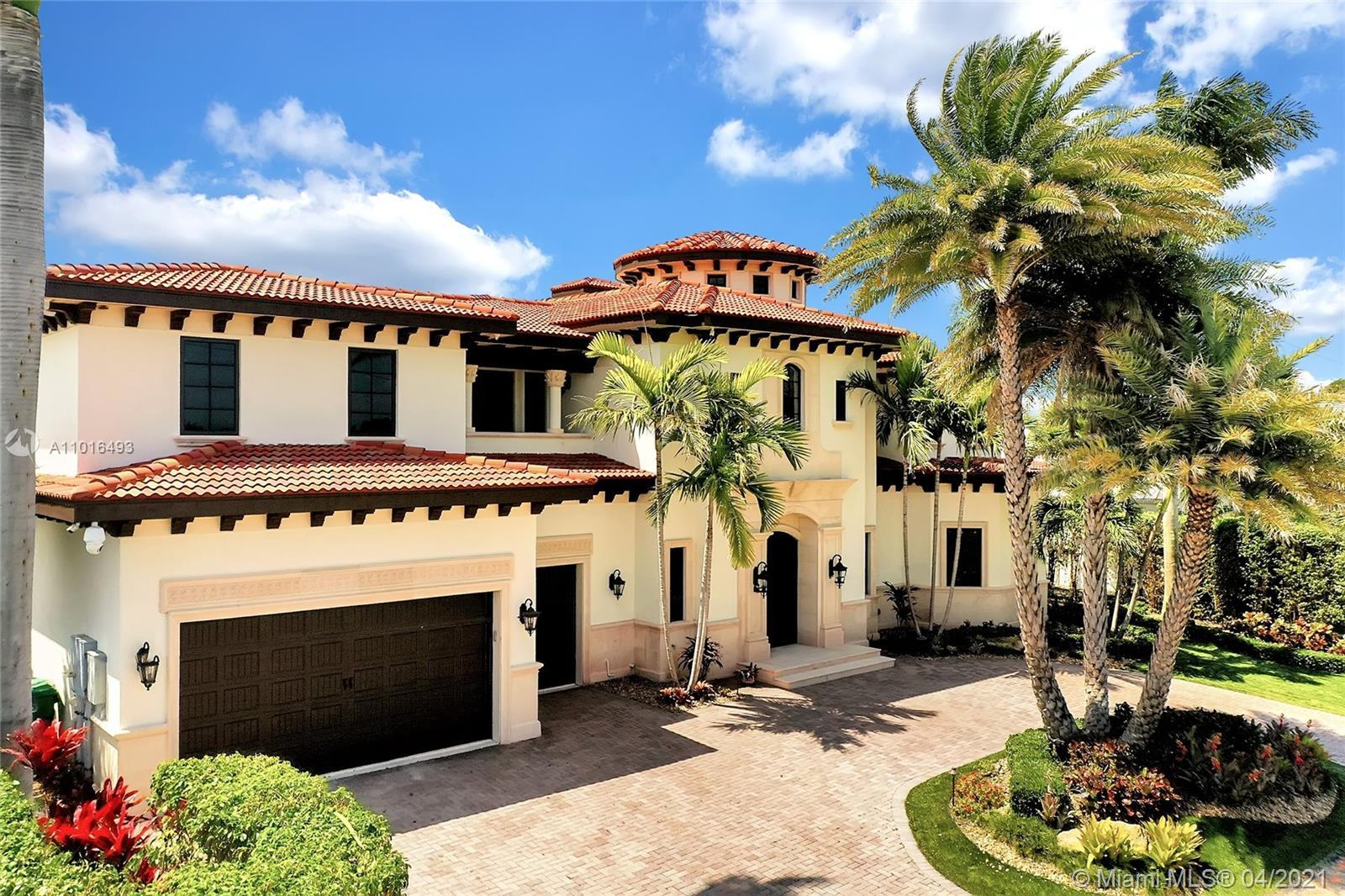 A Boaters Paradise in Palm Beach! This estate home features deep water with a 100' of waterfront for