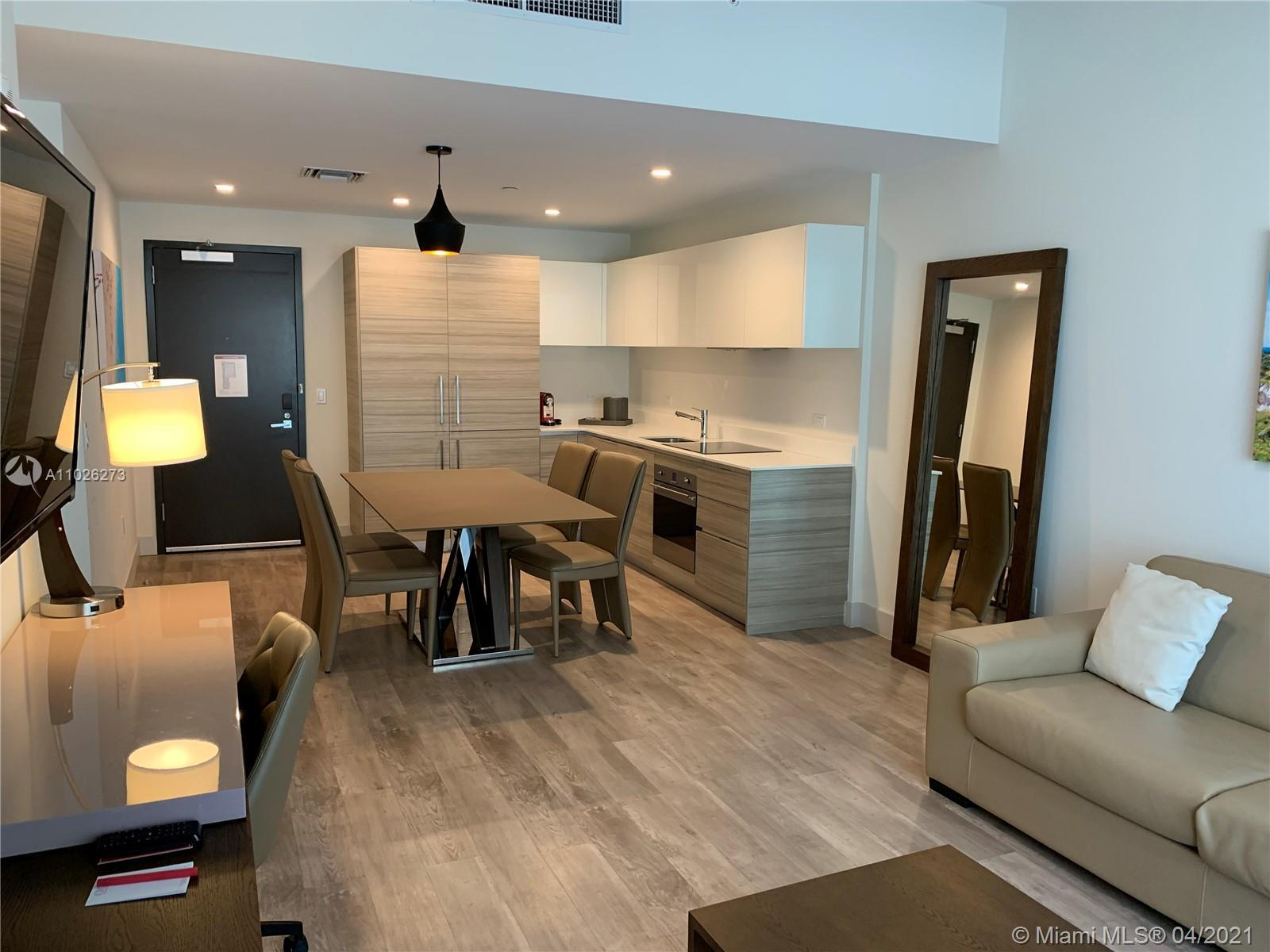 Modern furnished unit steps to Hollywood Beach Boardwalk. Unit had a 95% occupation rate in March 20