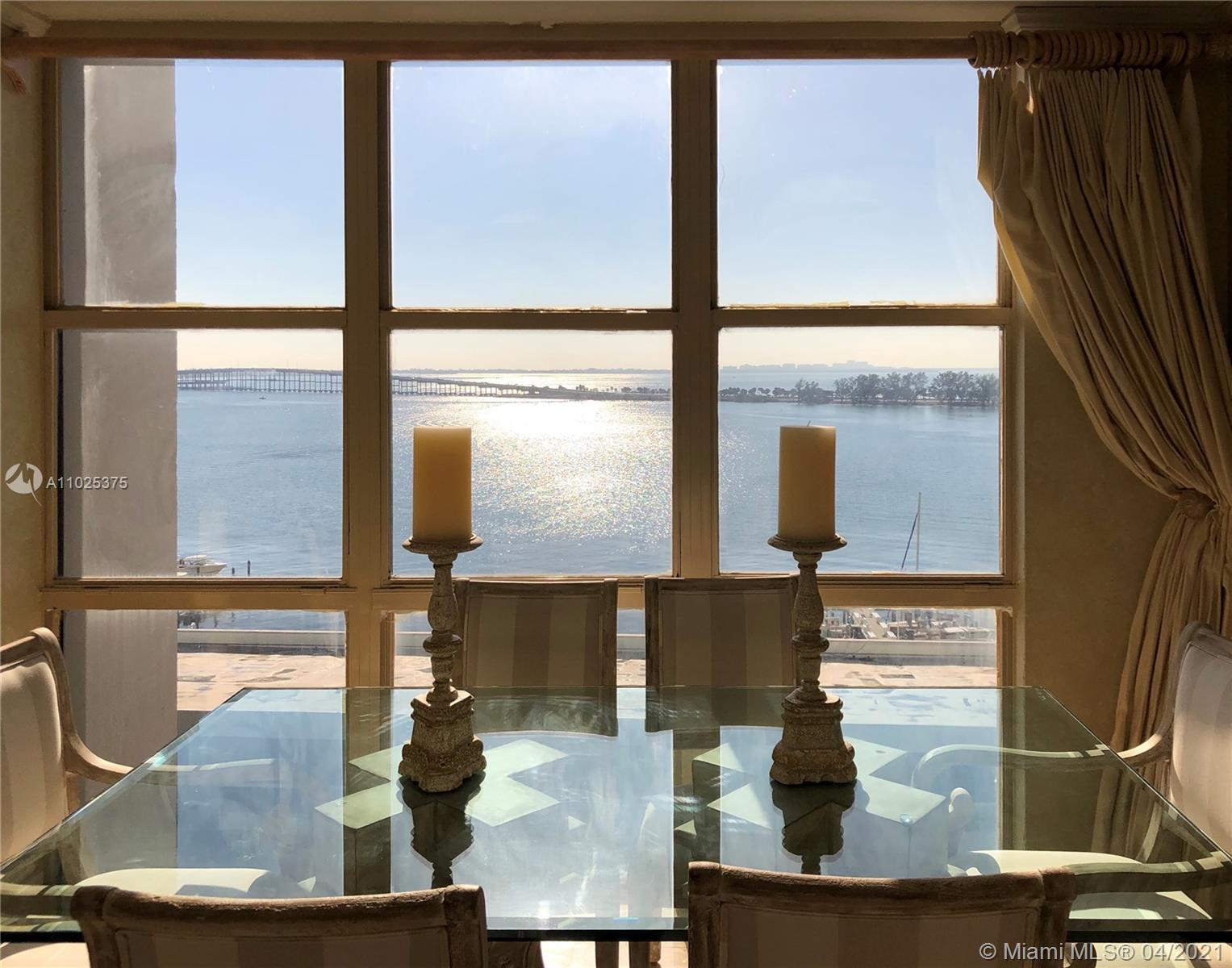 Rarely available corner unit, breathtaking bay and marina views. 3 bedrooms, 2.5 baths, with an encl