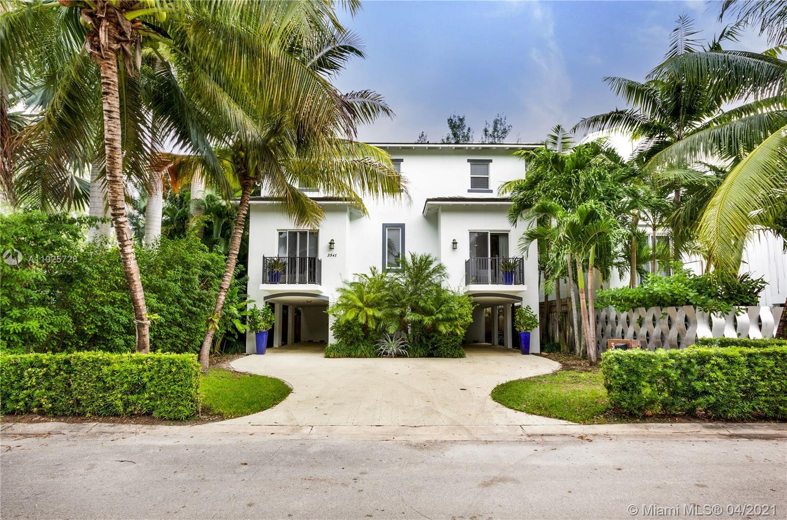 Enjoy all that Coconut Grove has o offer from this charming, light-filled, beautiful home! Main floo