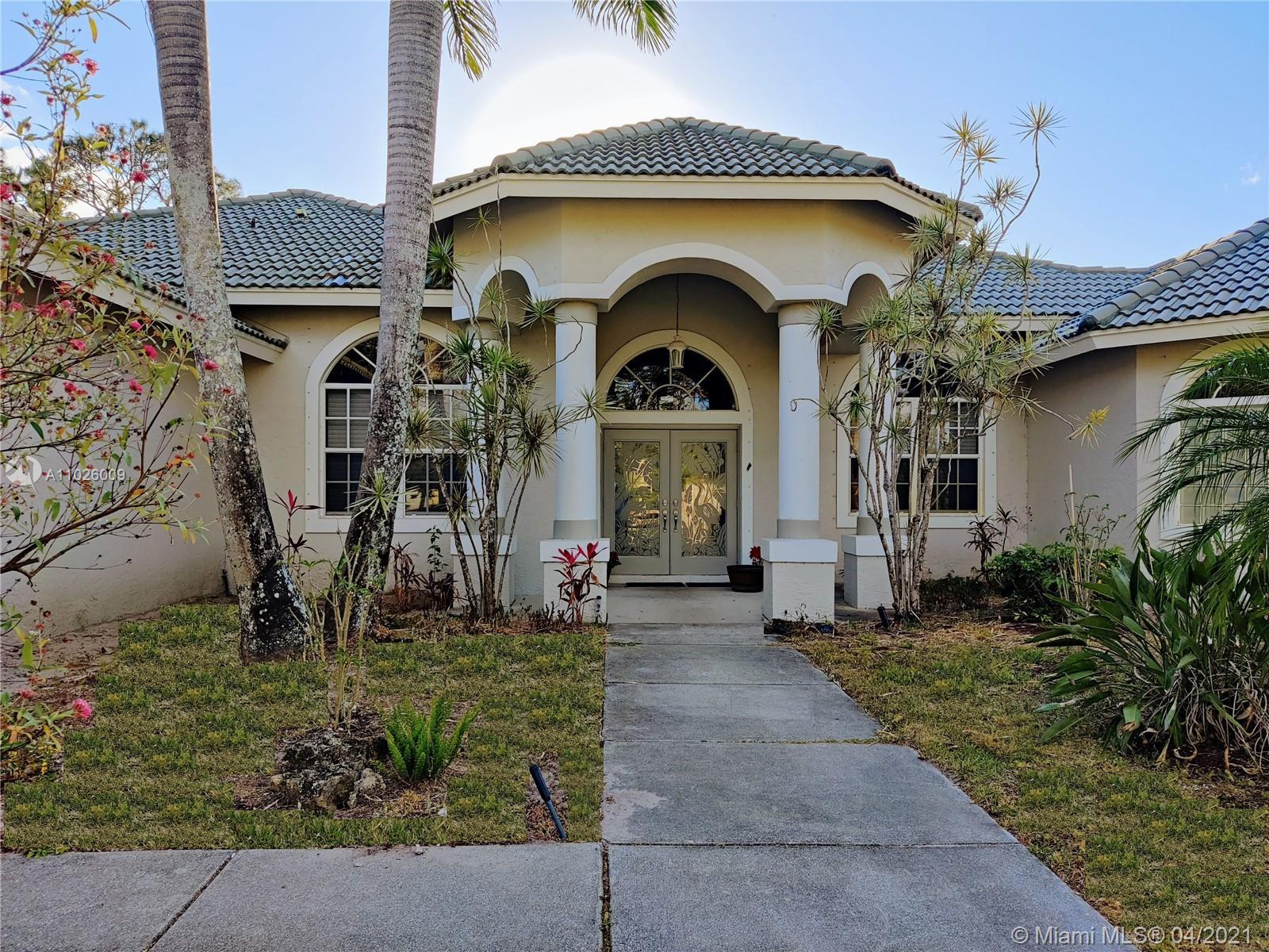 Gorgeous custom-built home (CBS) with horse barn sitting over on 2 acres Jupiter Farms! The main hom