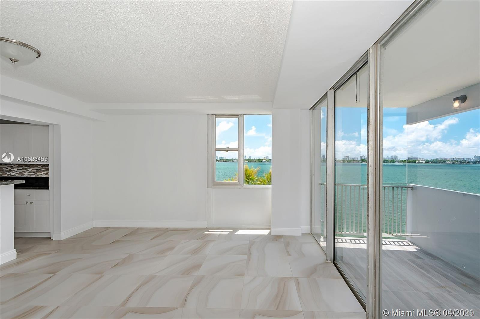 !!!!WONDERFULLY REMODELED CORNER UNIT APARTMENT WITH BEAUTIFUL VIEWS TO THE MIAMI BAY AND MIAMI BEAC