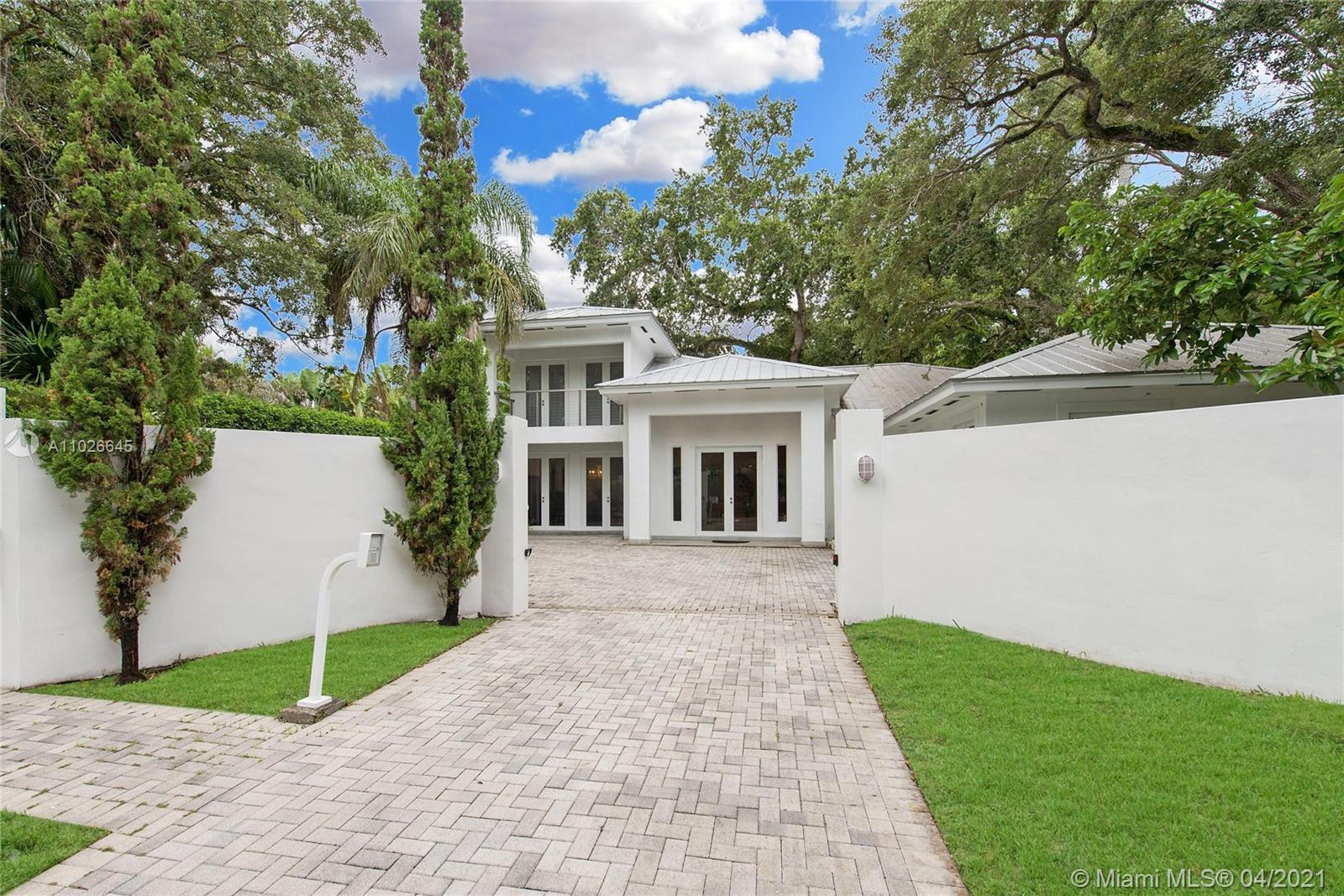 Lovely, walled & gated estate in lush South Coconut Grove. Custom built in 2004 by the current owner
