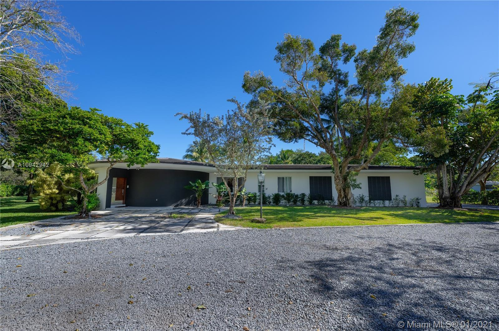 Fabulous one-story corner home sitting on a 1+ acre lot in the heart of Pinecrest. This contemporary