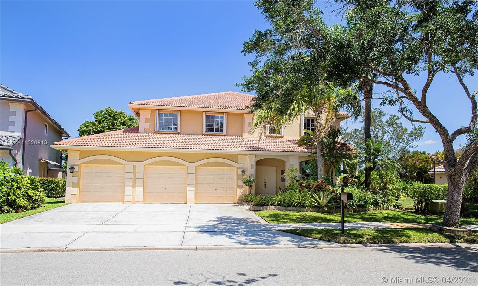 AMAZING HOME IN THE BEAUTIFUL CITY OF WESTON, BREATHTAKING WATER VIEWS EVERYWHERE, LOCATED ON ONE OF