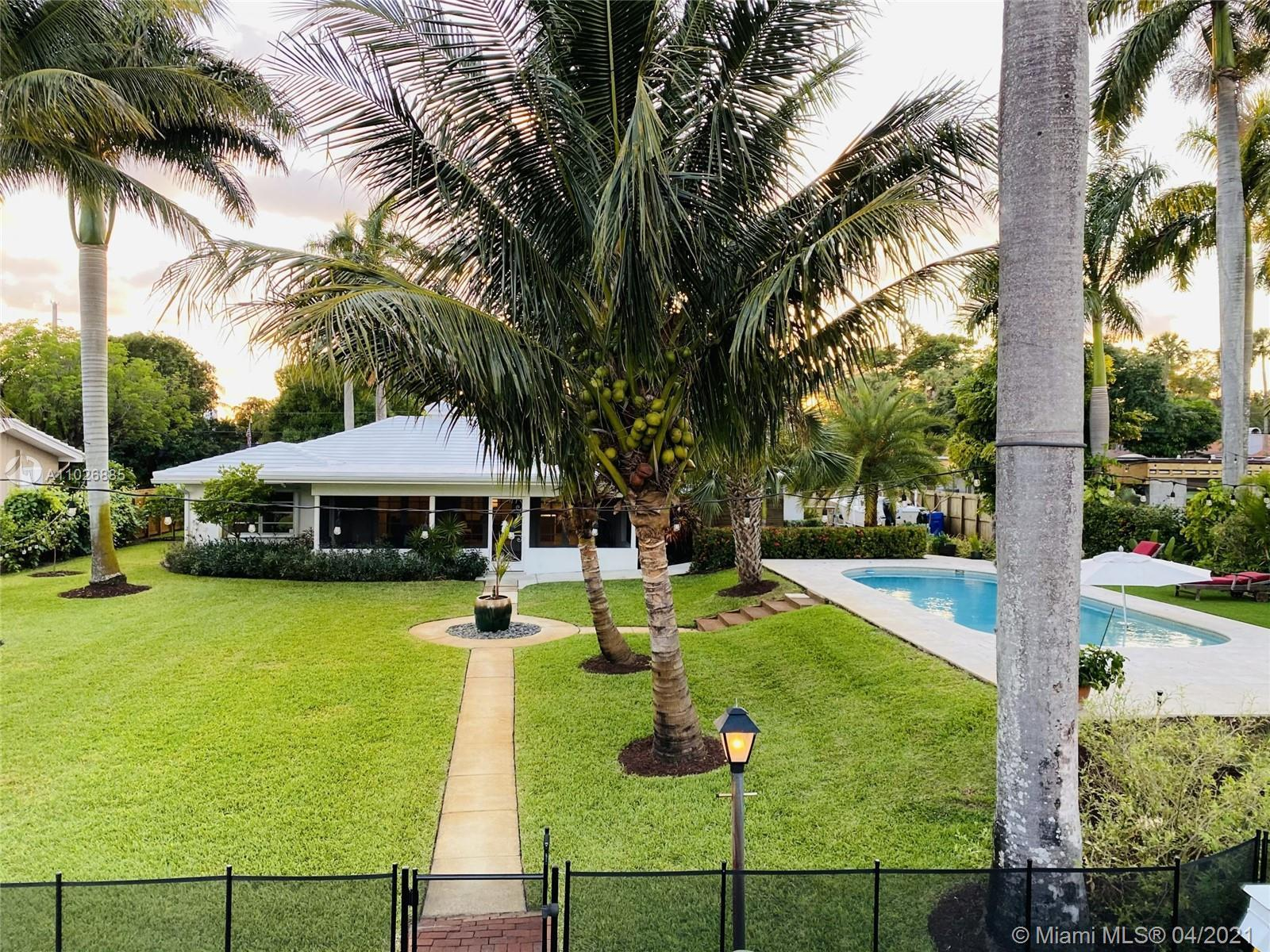 Classic south Florida home on beautiful tree-lined, dead end street. 100' waterfront with 90' dock o