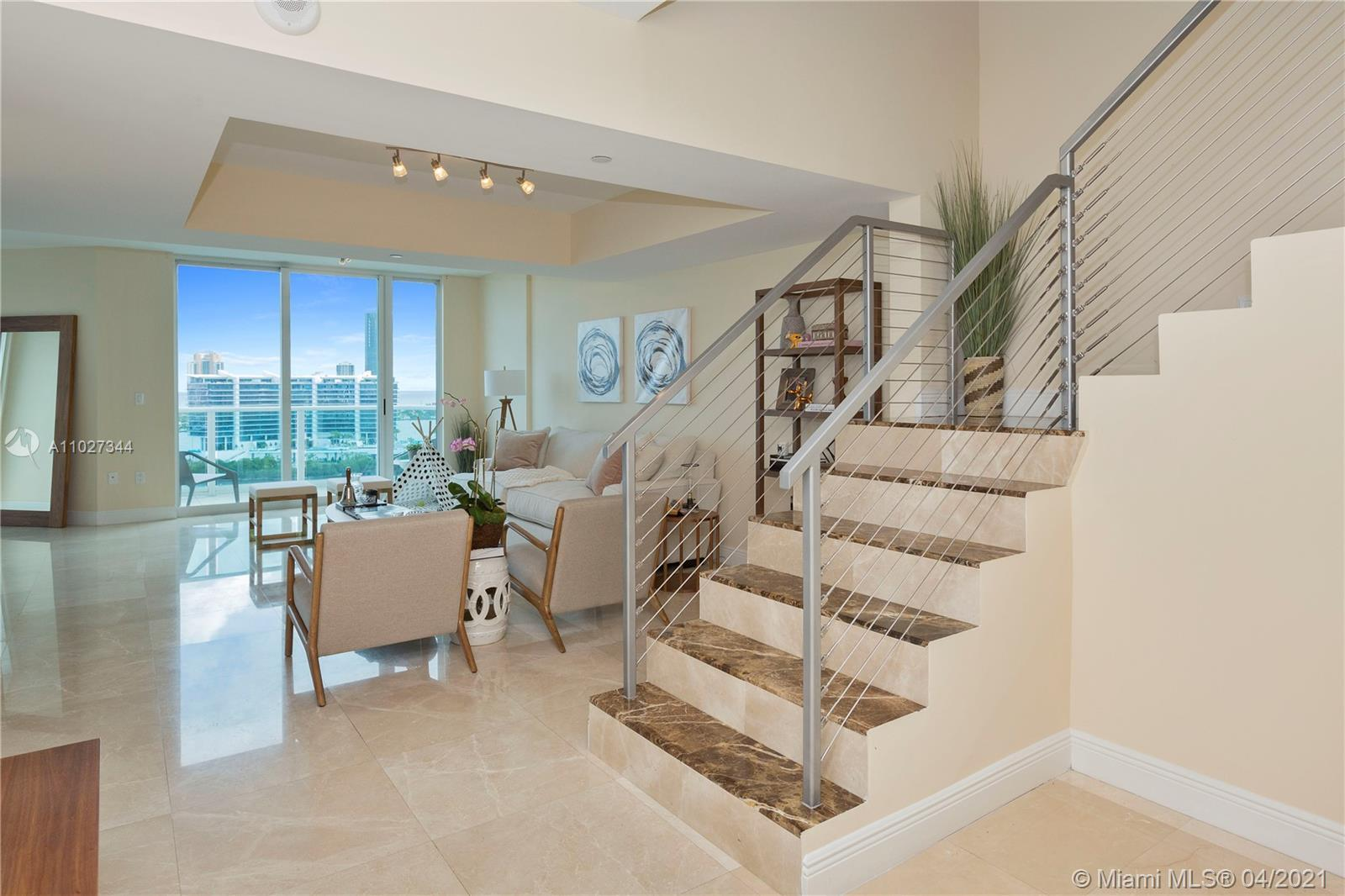 Enjoy living in this amazing Two-story waterfront Residence with fabulous Ocean, Intracoastal, and B