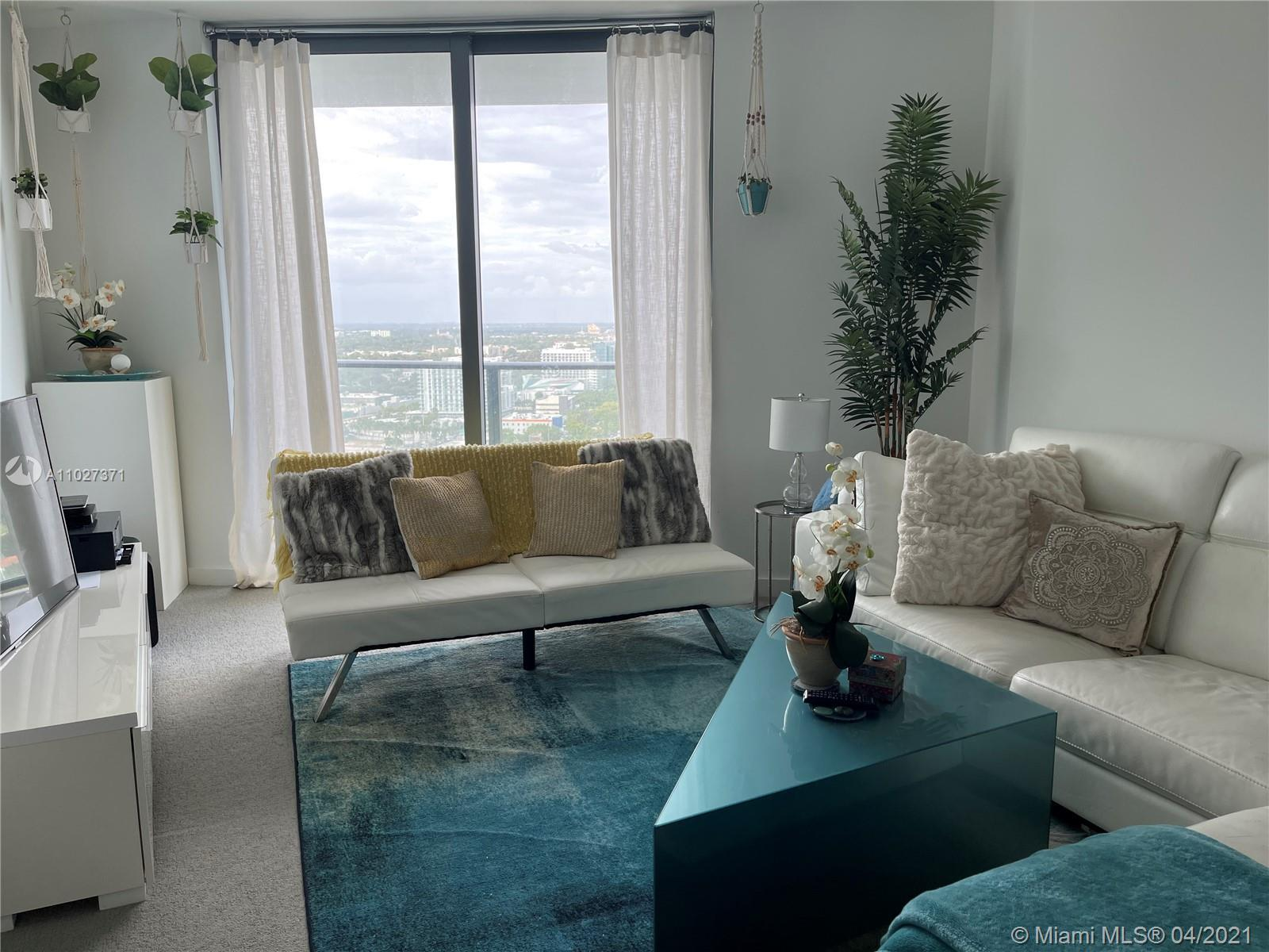 Amazing 2 bedroom, 2 baths + Den corner unit with wrap around balcony facing north and seeing all th