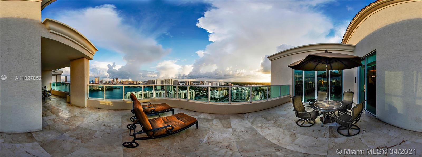 Breathtaking panoramic views of the ocean, Intracoastal & Sunny Isles skyline from this TWO-STORY PE
