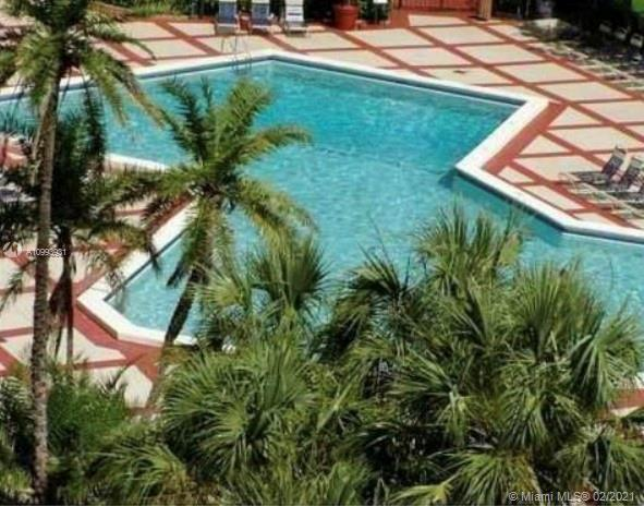 LARGEST UNIT IN THE COMPLEX. 2/2 on the 7th floor, overlooking spectacular heated pool and garden ar
