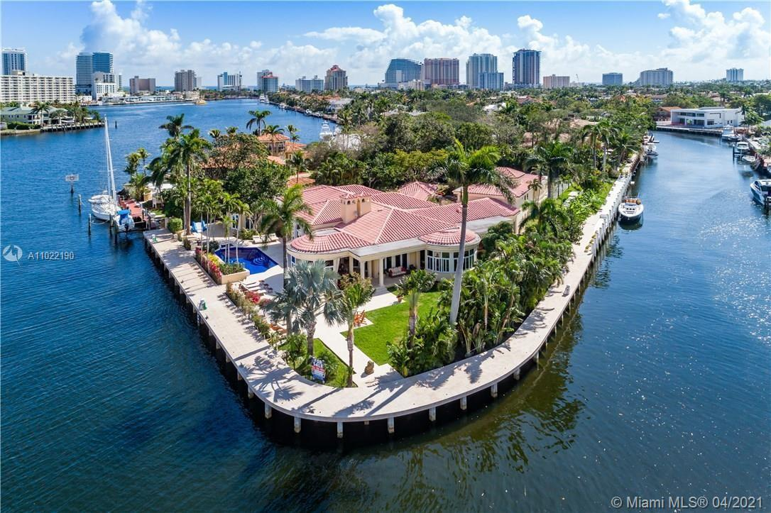 One- of- a- kind private point lot estate in Las Olas. 550 feet of  deep and wide protected waterfro