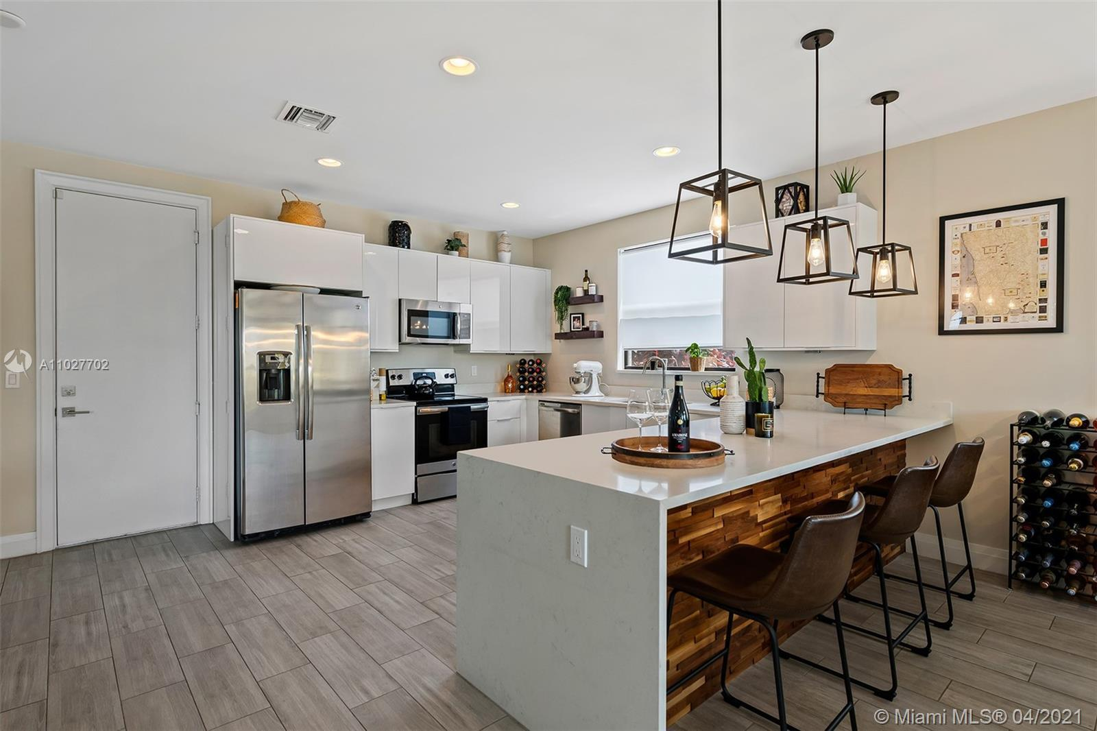 Don't miss this beautiful Modern townhome that is MOVE IN READY! This Gorgeous townhouse features a