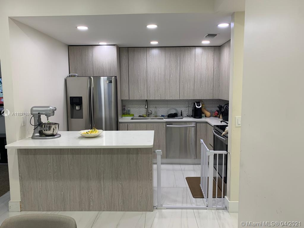 VERY NICE 1/2 DUPLEX. 4 BEDS 2 BATHS ALL REMOLDED NEW STAINLESS STEEL KITCHEN APPLIENCES. GRANITE TO